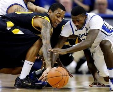 Virginia Commonwealth's Darius Theus, left, and Saint Louis' Mike McCall Jr., chase after a loose ball during the first half of an NCAA college basketball game, Tuesday, Feb. 19, 2013, in St. Louis. (AP Photo/Jeff Roberson) By Jeff Roberson