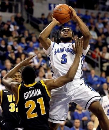 Saint Louis' Jordair Jett (5) shoots over Virginia Commonwealth's Treveon Graham during the second half of an NCAA college basketball game, Tuesday, Feb. 19, 2013, in St. Louis. Saint Louis won 76-62. (AP Photo/Jeff Roberson) By Jeff Roberson