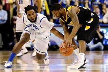 Saint Louis' Jordair Jett, left, and Virginia Commonwealth's Troy Daniels chase a loose ball during the second half of an NCAA college basketball game, Tuesday, Feb. 19, 2013, in St. Louis. Saint Louis won 76-62. (AP Photo/Jeff Roberson) By Jeff Roberson