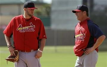 St. Louis Cardinals first baseman Matt Adams, left, talks to visiting coach Jim Edmonds during spring training baseball, Tuesday, Feb. 19, 2013, in Jupiter, Fla. (AP Photo/Julio Cortez) By Julio Cortez