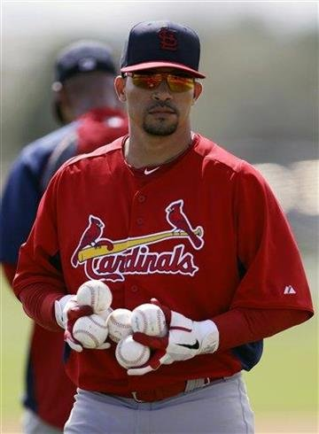 St. Louis Cardinals shortstop Rafael Furcal carries baseballs during spring training baseball, Tuesday, Feb. 19, 2013, in Jupiter, Fla. (AP Photo/Julio Cortez) By Julio Cortez