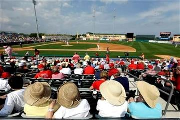 Spectators watch an exhibition spring training baseball game between the Houston Astros and the St. Louis Cardinals in Jupiter, Fla., Monday, Feb. 25, 2013. (AP Photo/Julio Cortez) By Julio Cortez