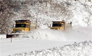 A pair of Pennsylvania Department of Transportation snow plows push snow from the northbound lanes of of Interstate 279 north of Pittsburgh,  Saturday, Feb. 6, 2010 after nearly 2 feet of snow fell in the area. (AP Photo/Keith Srakocic) By Keith Srakocic