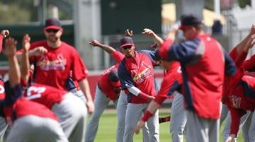 FORT MYERS, FL - FEBRUARY 26:  Members of the St. Louis Cardinals warm up prior to the start of the game against the Boston Red Sox at JetBlue Park on February 26, 2013 in Fort Myers, Florida.  (Photo by Leon Halip/Getty Images) By Leon Halip