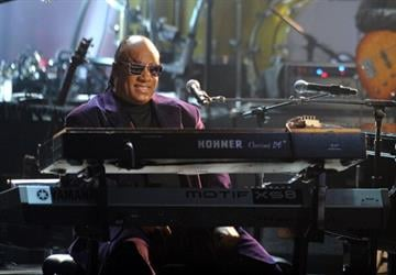 LOS ANGELES, CA - NOVEMBER 18:  Musician Stevie Wonder performs onstage during the 40th American Music Awards held at Nokia Theatre L.A. Live on November 18, 2012 in Los Angeles, California.  (Photo by Kevin Winter/Getty Images) By Kevin Winter