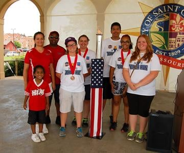 St. Charles Heat, SMSG bronze medal winners, with the torch (Courtesy: Kaia Fox, SMSG) By Bryce Moore