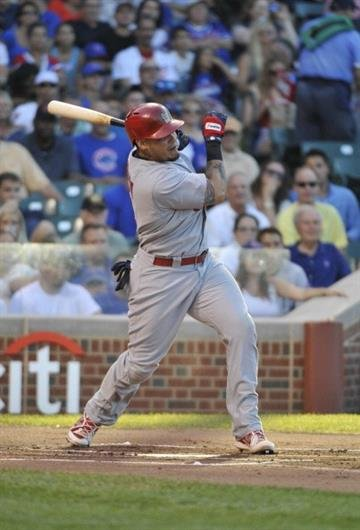 CHICAGO, IL - JULY 14: Yadier Molina #4 of the St. Louis Cardinals hits an RBI single against the Chicago Cubs during the first inning  on July 14, 2013 at Wrigley Field in Chicago, Illinois. (Photo by David Banks/Getty Images) By David Banks