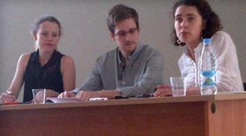 NSA leaker Edward Snowden attends a press conference at Moscow's Sheremetyevo Airport with Sarah Harrison of WikiLeaks, left, July 12, 2013, in this image provided by Human Rights Watch. / Twitter/Human Rights Watch - Tanya Lokshina By Belo Content KMOV