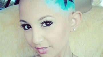 Talia Castellano poses in one of many fashion shoots posted on her Facebook page. Millions have seen her inspiring YouTube makeup tutorials. Castellano died of cancer at age 13 on July 16, 2013./ Facebook By Brendan Marks