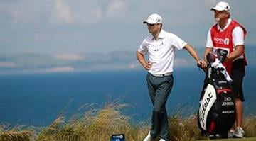 Zach Johnson of the United States prepares to play off the 12th tee during the first round of the British Open Golf Championship at Muirfield, Scotland, Thursday July 18, 2013. (AP Photo/Peter Morrison) By Peter Morrison