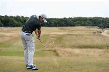 GULLANE, SCOTLAND - JULY 18:  Justin Rose of England hits a drive from the 8th hole during the first round of the 142nd Open Championship at Muirfield on July 18, 2013 in Gullane, Scotland.  (Photo by Stuart Franklin/Getty Images) By Stuart Franklin