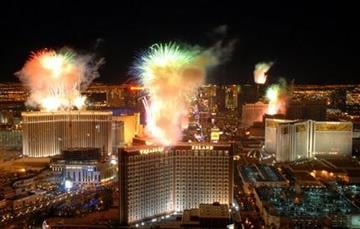 In this photo provided by the Las Vegas News Bureau, fireworks burst over the Las Vegas Strip at midnight on New Year's day Friday Jan. 1,  2010, as seen from Trump Las Vegas.   (AP Photo/Las Vegas News Bureau, Darrin Bush) By Darrin Bush