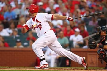 ST. LOUIS, MO - JULY 5:  Matt Holliday #7 of the St. Louis Cardinals hits an RBI double against the Miami Marlins  in the third inning at Busch Stadium on July 5, 2013 in St. Louis, Missouri.  (Photo by Dilip Vishwanat/Getty Images) By Dilip Vishwanat