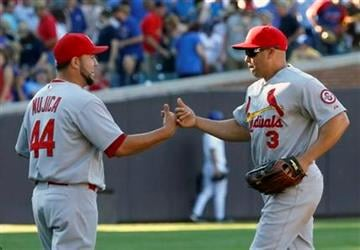 St. Louis Cardinals relief pitcher Edward Mujica (44) and right fielder Carlos Beltran celebrate a 3-2 win over the Chicago Cubs after a baseball game on Friday, July 12 2013, in Chicago. (AP Photo/Charles Rex Arbogast) By Charles Rex Arbogast