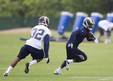 EARTH CITY, MO - MAY 10: Stedman Bailey (12) runs past Brandon McGee (32) of the St. Louis Rams during the 2013 St. Louis Rams rookie camp at Rams Park on May 10, 2013 in Earth City, Missouri. (Photo by David Welker/Getty Images) By David Welker