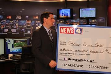 Steve Templeton presents a check for $1,100 to Michelle Beasley and Lillian Bales of Siteman Cancer Center By KMOV Web Producer