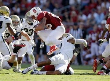 PALO ALTO, CA - OCTOBER 19:  Tyler Gaffney #25 of the Stanford Cardinal jumps over Anthony Barr #11 of the UCLA Bruins at Stanford Stadium on October 19, 2013 in Palo Alto, California.  (Photo by Ezra Shaw/Getty Images) By Ezra Shaw