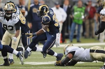 ST. LOUIS, MO - DECEMBER 15: Zac Stacy #30 of the St. Louis Rams rushes against the New Orleans Saints in the third quarter at the Edward Jones Dome on December 15, 2013 in St. Louis, Missouri.  (Photo by Michael Thomas/Getty Images) By Michael Thomas