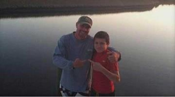 Darrin Spivey, 35, seen with his son, Dillon Sanchez, 15, in this undated Facebook photo.  FACEBOOK By KMOV