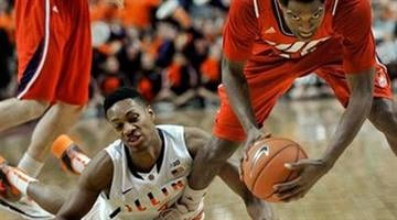 Illinois-Chicago's Kelsey Barlow, right, battles for a loose ball against Illinois' Joseph Bertrand (2) during the second half of an NCAA college basketball game in Chicago, Saturday, Dec., 28, 2013. Illinois won 74-60. (AP Photo/Paul Beaty) By Paul Beaty