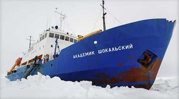 In this image provided by Australasian Antarctic Expedition/Footloose Fotography the Russian ship MV Akademik Shokalskiy is trapped in thick Antarctic ice, Friday, Dec. 27, 2013.  ANDREW PEACOCK, AP By Andrew Peacock / AP