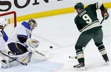 St. Louis Blues goalie Brian Elliott (1) deflects a shot by Minnesota Wild center Mikko Koivu (9), of Finland, during the first period of an NHL hockey game in St. Paul, Minn., Tuesday, Dec. 31, 2013. (AP Photo/Ann Heisenfelt) By Ann Heisenfelt