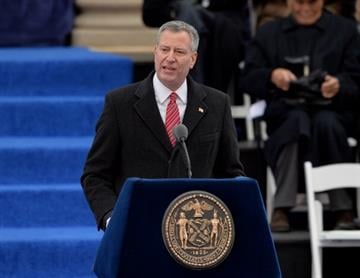 New York City Mayor Bill de Blasio speaks after being sworn in on the steps of City Hall in Lower Manhattan January 1, 2014 in New York.  AFP PHOTO/Stan HONDA        (Photo credit should read STAN HONDA/AFP/Getty Images) By STAN HONDA