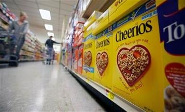 In this June 16, 2011 photo, boxes of Cheerios are shown in a store in Akron, N.Y.  The iconic cereal from General Mills is 70 years old this year. (AP Photo/David Duprey) By David Duprey