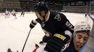 St. Louis Blues defenseman Barret Jackman slams Columbus Blue Jackets right wing Cam Atkinson against the boards during the first period of an NHL hockey game Saturday, Jan. 4, 2014, in St. Louis. (AP Photo/St. Louis Post-Dispatch, Chris Lee) By Chris Lee