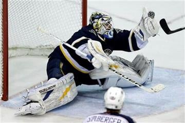 St. Louis Blues goalie Brian Elliott makes a glove save during the third period of an NHL hockey game against the Columbus Blue Jackets on Saturday, Jan. 4, 2014, in St. Louis. The Blues won 6-2. (AP Photo/Jeff Roberson) By Jeff Roberson