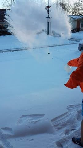 Kids throwing hot water into the freezing air in Florissant. By Stephanie Baumer