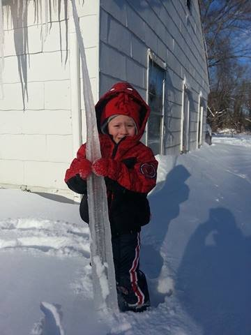 My 3 year old son is holding an icicle that is 5 1/2 feet long! By Stephanie Baumer