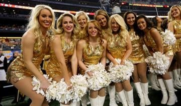 ARLINGTON, TX - JANUARY 03:  Missouri Tigers cheerleaders pose before the Tigers take on the Oklahoma State Cowboys in the AT&T Cotton Bowl on January 3, 2014 in Arlington, Texas.  (Photo by Ronald Martinez/Getty Images) By Ronald Martinez