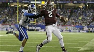 Texas A&M quarterback Johnny Manziel (2) scores a touchdown as Duke safety Jeremy Cash (16) defends in the second half of the Chick-fil-A Bowl NCAA college football game Tuesday, Dec. 31, 2013, in Atlanta. (AP Photo/John Bazemore) By John Bazemore