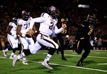 COLUMBIA, MO - NOVEMBER 30:  Quarterback Johnny Manziel #2 of the Texas A&M Aggies scrambles during the game against the Missouri Tigers on November 30, 2013 in Columbia, Missouri.  (Photo by Jamie Squire/Getty Images) By Jamie Squire