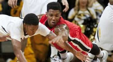 Georgia's Charles Mann, right, and Missouri's Wes Clark, left, battle for a loose ball during the first half of an NCAA college basketball game Wednesday, Jan. 8, 2014, in Columbia, Mo. (AP Photo/L.G. Patterson) By L.G. Patterson