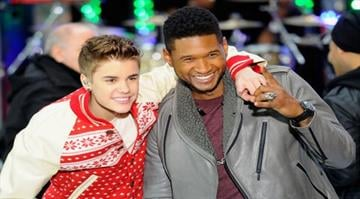 """NEW YORK, NY - NOVEMBER 23:  (L-R)  Justin Bieber and Usher perform on NBC's """"Today"""" in the TODAY Plaza on November 23, 2011 in New York City.  (Photo by Andrew H. Walker/Getty Images) By Andrew H. Walker"""