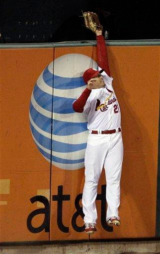 St. Louis Cardinals' Allen Craig catches a fly ball off the bat of Texas Rangers' Nelson Cruz during the sixth inning of Game 7 of baseball's World Series Friday, Oct. 28, 2011, in St. Louis. (AP Photo/Paul Sancya) By Paul Sancya
