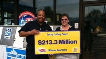 Store owner holds lottery check with lottery official, awaiting somebody to come forward with the winning ticket. By KMOV Web Producer