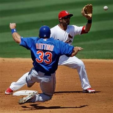 St. Louis Cardinals second baseman Daniel Descalso catches a ball to force out New York Mets' Vinny Rottino in the fourth inning of a spring training baseball game in Jupiter, Fla., Friday, March 30, 2012. (AP Photo/Patrick Semansky) By Patrick Semansky