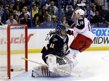 Columbus Blue Jackets' R.J. Umberger (18) scores past St. Louis Blues goalie Jaroslav Halak, of Slovakia, during the first period of an NHL hockey game, Saturday, March 31, 2012, in St. Louis. (AP Photo/Jeff Roberson) By Jeff Roberson