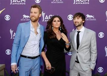 From left, Charles Kelley, Hillary Scott and Dave Haywood, of musical group Lady Antebellum, arrive at the 47th Annual Academy of Country Music Awards on Sunday, April 1, 2012 in Las Vegas. (AP Photo/Isaac Brekken) By Isaac Brekken