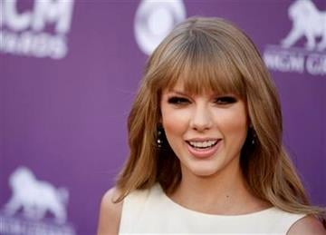 Taylor Swift arrives at the 47th Annual Academy of Country Music Awards on Sunday, April 1, 2012 in Las Vegas. (AP Photo/Isaac Brekken) By Isaac Brekken