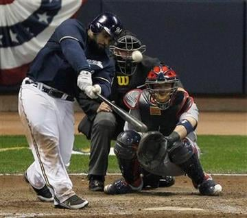 Milwaukee Brewers' Prince Fielder hits a home run during the eighth inning of Game 2 of baseball's National League championship series against the St. Louis Cardinals Monday, Oct. 10, 2011, in Milwaukee. (AP Photo/Jeff Roberson) By Jeff Roberson