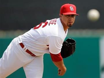 St. Louis Cardinals starting pitcher Kyle Lohse warms up between innings during a spring training baseball game against the Minnesota Twins in Jupiter, Fla., Sunday, March 25, 2012. (AP Photo/Patrick Semansky) By Patrick Semansky