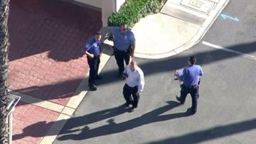 Police work at the scene of a shooting in Bell Gardens, where a City Hall worker said the mayor was shot on Sept. 30, 2014.Embargoed to Los Angeles, CA By KTLA
