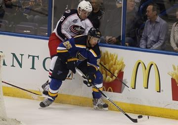 Columbus Blue Jackets Marko Dano climbs the back of St. Louis Blues Chris Butler in the first perod at the Scottrade Center in St. Louis on September 25, 2014. UPI/BIll Greenblatt By BILL GREENBLATT