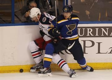 St. Louis Blues Ian Cole presses Columbus Blue Jackets Scott Hartnell into the boards during the first period at the Scottrade Center in St. Louis on September 25, 2014. UPI/BIll Greenblatt By BILL GREENBLATT