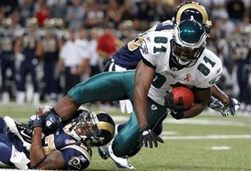 Philadelphia Eagles wide receiver Jason Avant (81) holds onto a pass over St. Louis Rams defensive back Quintin Mikell (27) during the first quarter of an NFL football game, Sunday, Sept. 11, 2011 in St. Louis. (AP Photo/Jeff Roberson) By Jeff Roberson