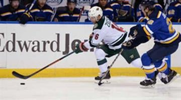 Minnesota Wild's Jason Zucker (16) skates by St. Louis Blues' Kevin Shattenkirk (22) during the first period of a preseason NHL hockey game, Thursday, Oct. 2, 2014, in St. Louis. (AP Photo/Bill Boyce) By Bill Boyce